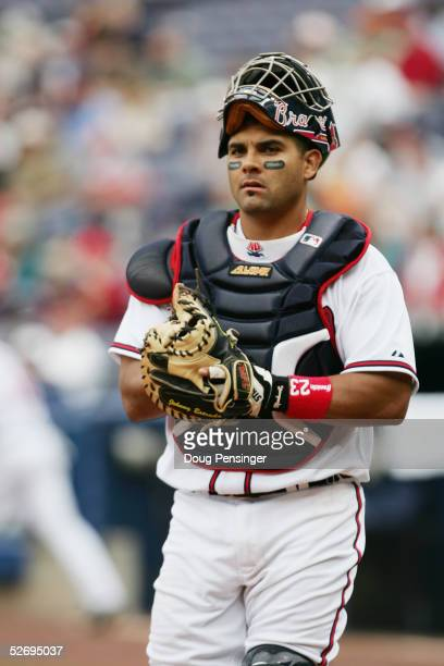 Catcher Johnny Estrada of the Atlanta Braves looks on against the Washington Nationals at Turner Field on April 13, 2005 in Atlanta, Georgia. The...