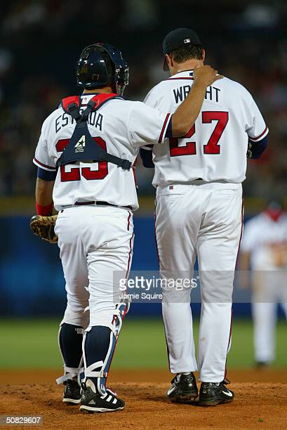 Catcher Johnny Estrada talks with pitcher Jaret Wright of the Atlanta Braves during the game against the Florida Marlins at Turner Field on April 16...