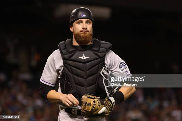 Catcher Jonathan Lucroy of the Colorado Rockies walks off the field during the MLB game against the Arizona Diamondbacks at Chase Field on September...