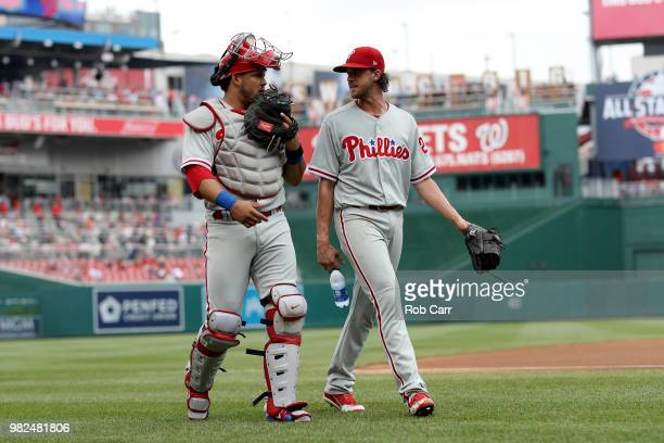 Catcher Jorge Alfaro and starting pitcher Aaron Nola of the Philadelphia Phillies walk in from the bullpen before the start of the Phillies and...