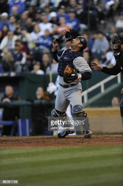 Catcher Jorge Posada of the New York Yankees fields his position as he reacts to an infield pop fly in front of home plate during the game against...