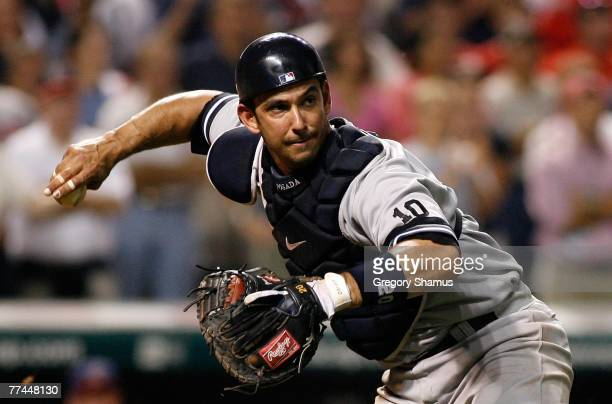 Catcher Jorge Posada of the New York Yankees looks to throw the ball to first for a force out against the Cleveland Indians during Game Two of the...