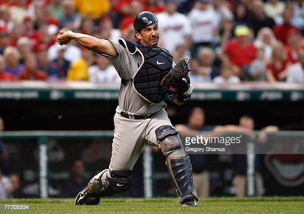Catcher Jorge Posada of the New York Yankees throws to first to force out Jason Michaels of the Cleveland Indians on Michaels sacrifice bunt during...