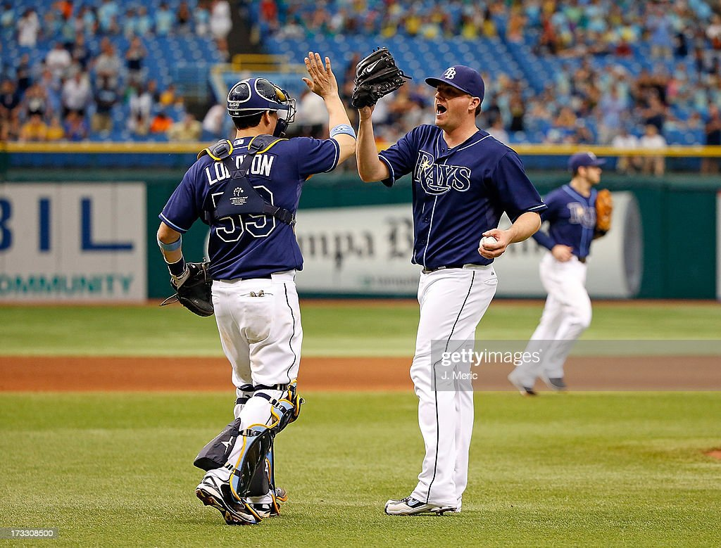 Catcher Jose Lobaton #59 of the Tampa Bay Rays congratulates pitcher Jake McGee #57 after his save against the Minnesota Twins at Tropicana Field on July 11, 2013 in St. Petersburg, Florida.