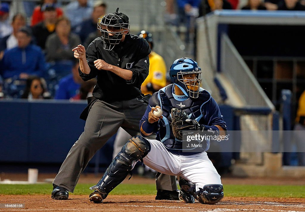 Catcher Jose Molina #28 of the Tampa Bay Rays catches as homeplate umpire Kolin Kline calls a strike against the Pittsburgh Pirates during a Grapefruit League Spring Training Game at the Charlotte Sports Complex on March 25, 2013 in Port Charlotte, Florida.