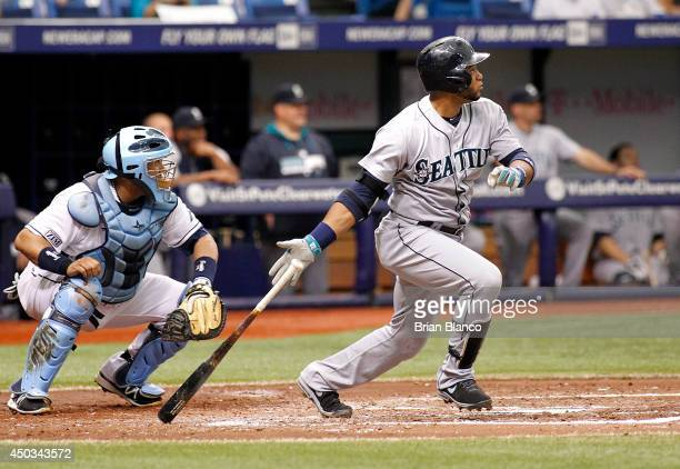 Catcher Jose Molina of the Tampa Bay Rays looks on as Robinson Cano of the Seattle Mariners hits a tworun single during the third inning of a game on...