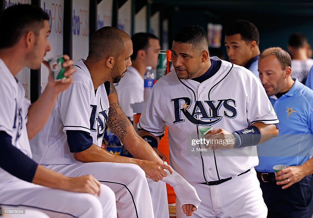 Catcher Jose Molina #28 of the Tampa Bay Rays talks with pitcher David Price #14 between innings against the Houston Astros during the game at Tropicana Field on July 12, 2013 in St. Petersburg, Florida.