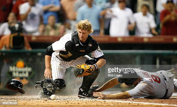 Catcher JR Towles of the Houston Astros can't hang on to the ball as he is hit by Troy Glaus of the St Louis Cardinals in the eighth inning to tie...
