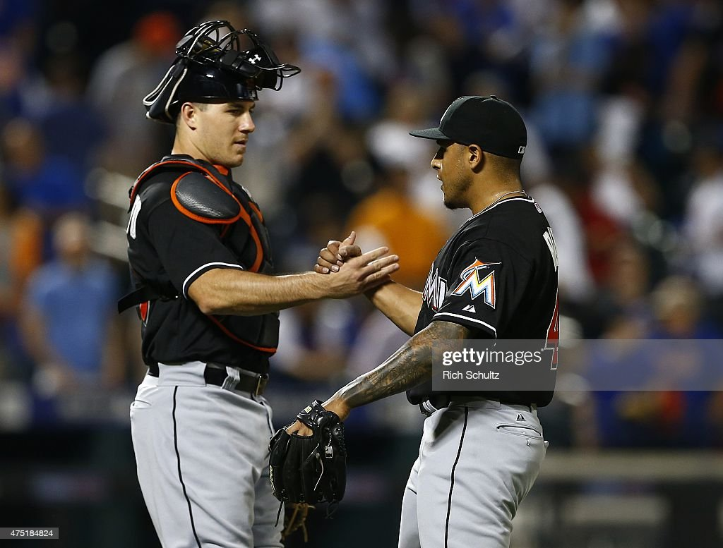 Catcher J.T. Realmuto #20 congratulates pitcher A.J. Ramos #44 of the Miami Marlins after defeating the New York Mets 4-3 on May 29, 2015 at Citi Field in the Flushing neighborhood of the Queens borough of New York City.