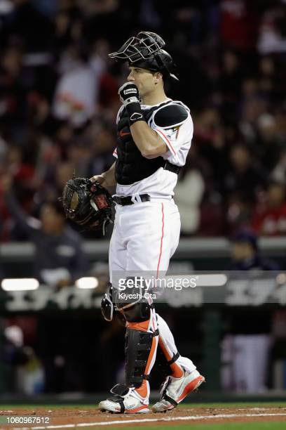 Catcher JT Realmuto of the Miami Marlins reacts as Infielder Kosuke Tanaka of Japan hits a RBI single to make it 33 in the top of 9th inning during...