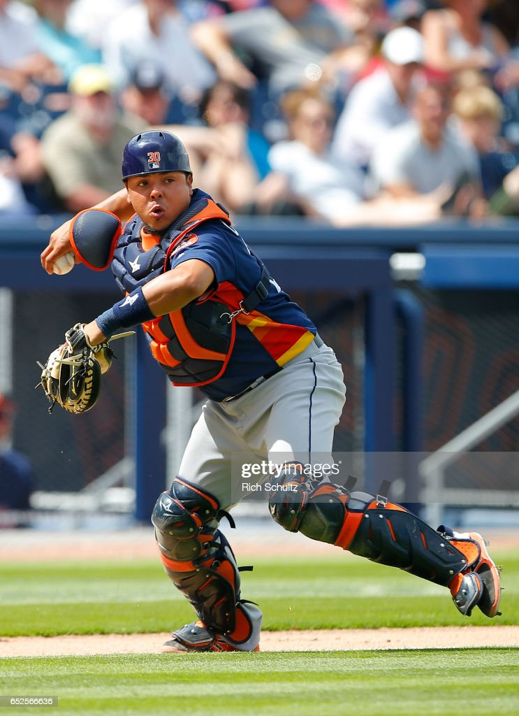 Catcher Juan Centeno #30 of the Houston Astros attempts to throw out Trea Turner #7 of the Washington Nationals who safely made it to first base for an infield single during the fifth inning of a spring training baseball game on March 12, 2017 in West Palm Beach, Florida.