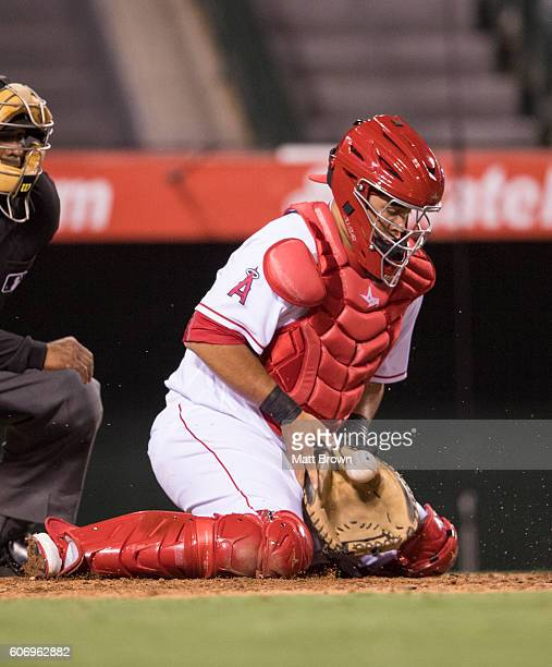 Catcher Juan Graterol of the Los Angeles Angels of Anaheim stops a pitch in the dirt with Ketel Marte of the Seattle Mariners at bat during the...
