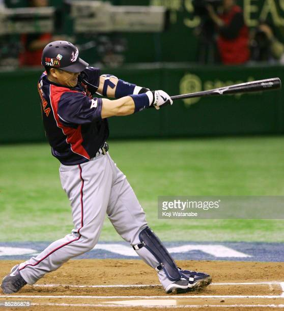 Catcher Kenji Johjima of Japan hits a tworun homer in the top of sixth inning during the World Baseball Classic Tokyo Round match between Japan and...
