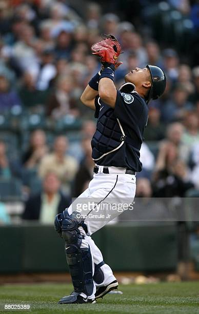 Catcher Kenji Johjima of the Seattle Mariners waits to field an infield flyball during the game against the San Francisco Giants on May 22 2009 in...
