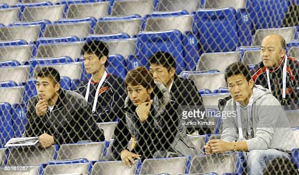 Catcher Kenji Johjima pitcher Yu Darvish and pitcher Masahiro Tanaka of Japan watch a friendly match between China and Saitama Seibu Lions at Tokyo...