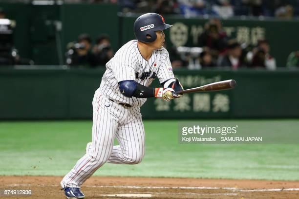 Catcher Kensuke Kondo of Japan hits a single in the bottom of eighth inning during the Eneos Asia Professional Baseball Championship 2017 game...