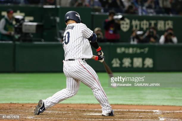 Catcher Kensuke Kondo of Japan hits a single in the bottom of third inning during the Eneos Asia Professional Baseball Championship 2017 game between...