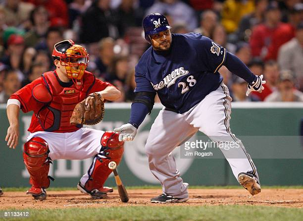 Catcher Kevin Cash of the Boston Red Sox watches as Prince Fielder of the Milwaukee Brewers makes contact during the second game of a doubleheader at...