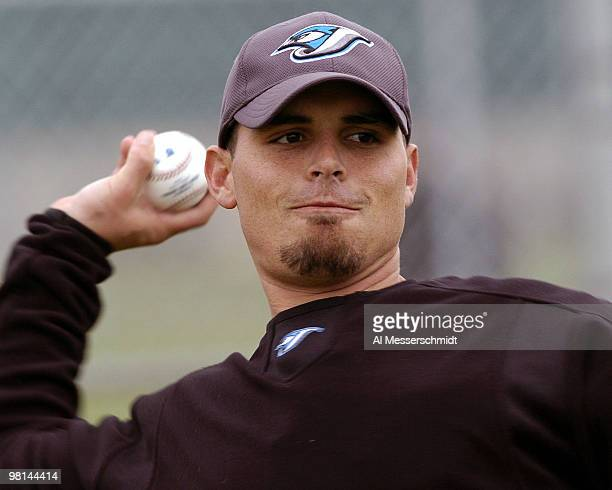 Catcher kevin Cash tosses a ball during spring training drills at the Toronto Blue Jays camp in Dunedin Florida February 27 2004
