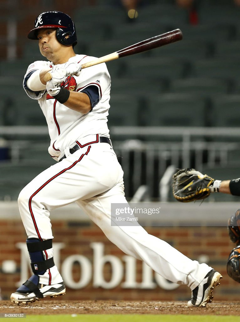 Catcher Kurt Suzuki #24 of the Atlanta Braves hits a walkoff, game-winning single in the ninth inning during the game against the Miami Marlins at SunTrust Park on September 7, 2017 in Atlanta, Georgia.