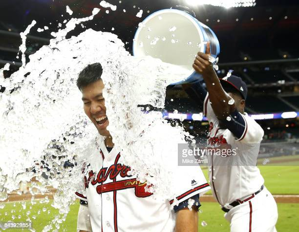 Catcher Kurt Suzuki of the Atlanta Braves is doused with water after his walkoff gamewinning single in the ninth inning during the game against the...