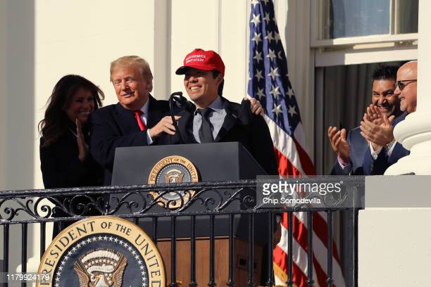 Catcher Kurt Suzuki wears a Make America Great Again hat as US President Donald Trump and first lady Melania Trump welcomes the 2019 World Series...