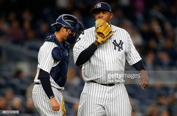Catcher Kyle Higashioka talks with pitcher CC Sabathia of the New York Yankees against the Toronto Blue Jays during a game at Yankee Stadium on May 3...
