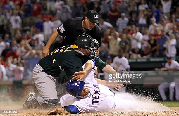 Catcher Landon Powell of the Oakland Athletics makes the out against Andres Blanco of the Texas Rangers in the 12th inning on May 11 2010 at Rangers...