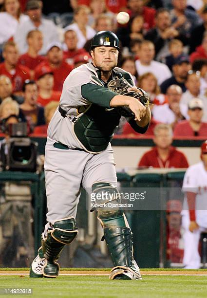 Catcher Landon Powell of the Oakland Athletics throws to first base during the baseball game against the Los Angeles Angels of Anaheim at Angel...