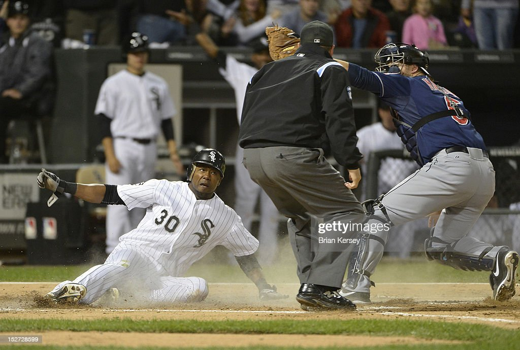 Catcher Lou Marson #6 of the Cleveland Indians (R) tags out Alejandro De Aza #30 of the Chicago White Sox at home plate after he tried to score on a double hit by Kevin Youkilis #20 during the fourth inning at U.S. Cellular Field on September 24, 2012 in Chicago, Illinois.