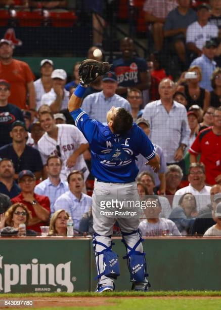 Catcher Luke Maile of the Toronto Blue Jays catches a pop ball from Mitch Moreland of the Boston Red Sox in foul territory in the bottom of the...