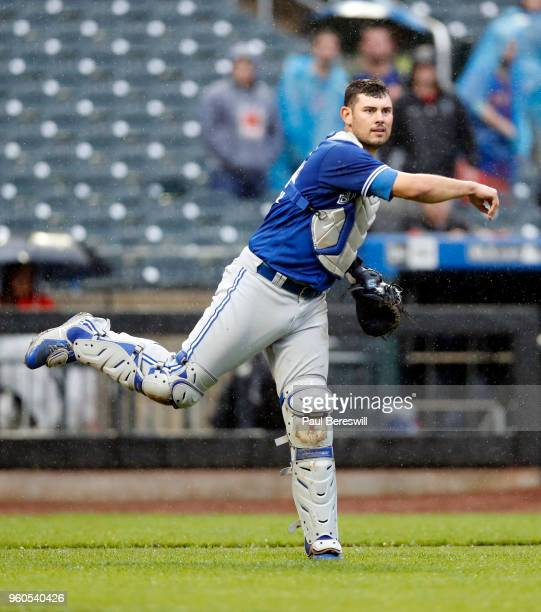 Catcher Luke Maile of the Toronto Blue Jays throws to first base during a interleague MLB baseball game against the New York Mets on May 16 2018 at...