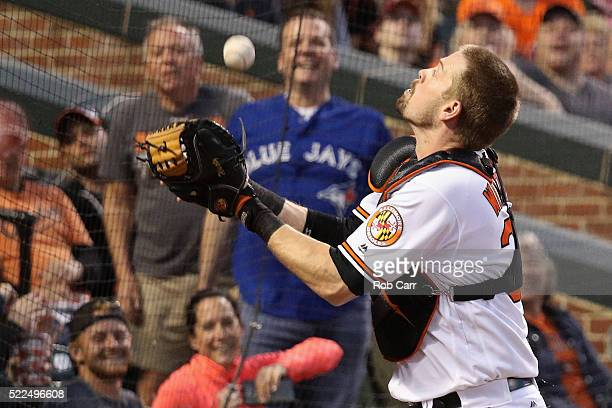 Catcher Matt Wieters of the Baltimore Orioles catches a foul ball hit by Edwin Encarnacion of the Toronto Blue Jays for the second out of the third...