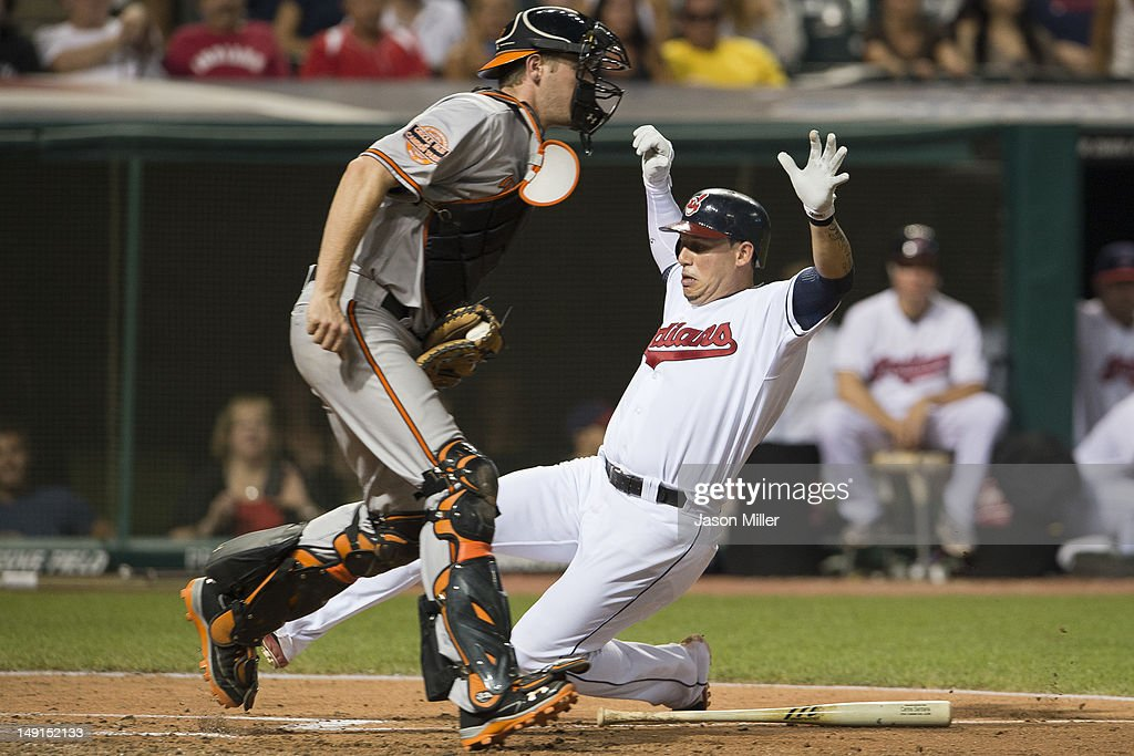 Catcher Matt Wieters #32 of the Baltimore Orioles forces out Asdrubal Cabrera #13 of the Cleveland Indians at home plate during the eighth inning at Progressive Field on July 23, 2012 in Cleveland, Ohio.