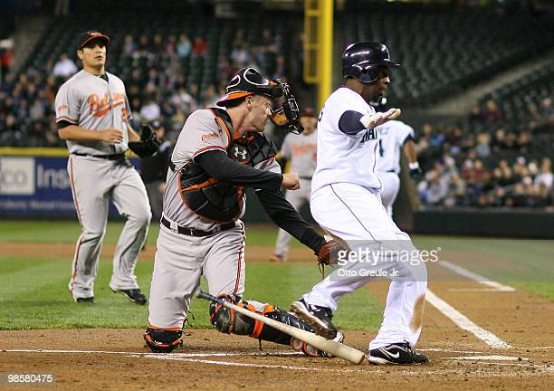 Catcher Matt Wieters of the Baltimore Orioles tags out Chone Figgins of the Seattle Mariners at Safeco Field on April 20 2010 in Seattle Washington