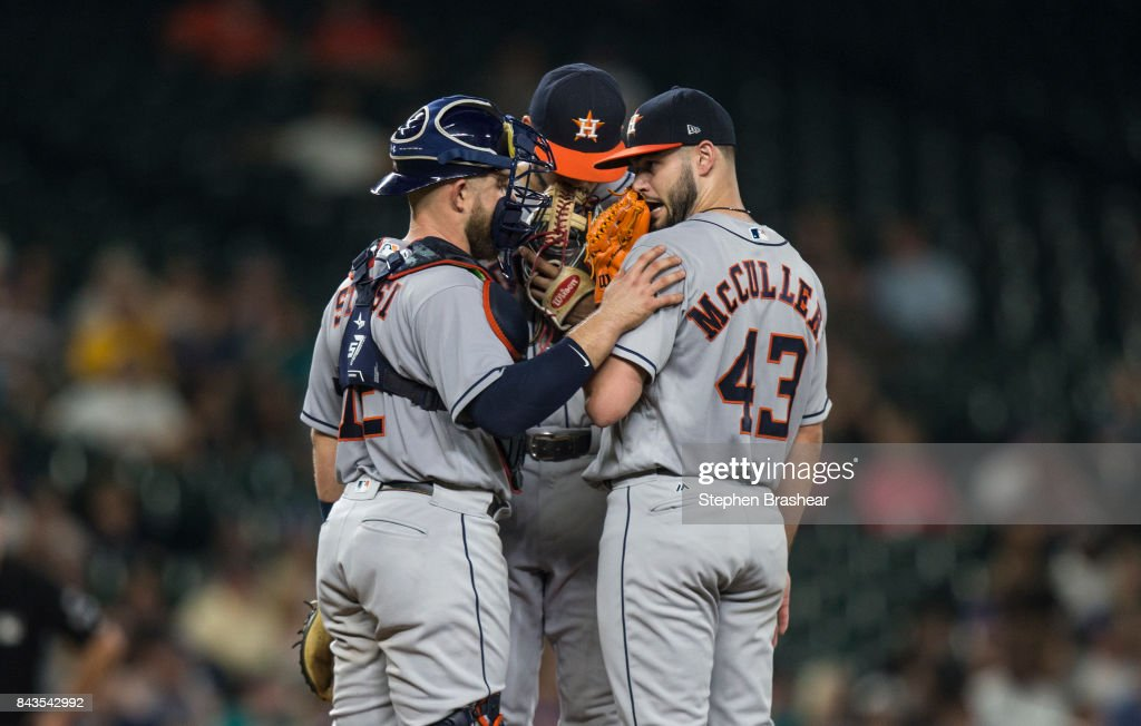 Catcher Max Stassi #12 of the Houston Astros, shortstop Carlos Correa #1 of the Houston Astros and starting pitcher Lance McCullers Jr. of the Houston Astros meet at the pitcher's mound during the sixth inning of a game at Safeco Field on September 6, 2017 in Seattle, Washington.