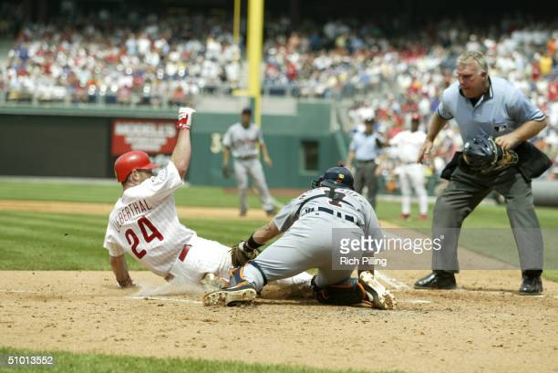 Catcher Mike Lieberthal of the Philadelphia Phillies attempts to score on catcher Ivan Rodriguez of the Detroit Tigers during the interleague game at...