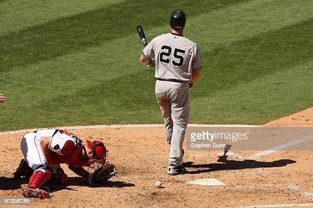 Catcher Mike Napoli of the Los Angeles Angels of Anaheim reacts in pain after being hit by a foul tip by Mark Teixeira of the New York Yankees on...