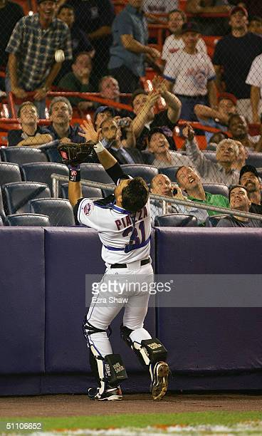 Catcher Mike Piazza of the New York Mets attempts to catch the ball against the Philidelphia Phillies during the game at Shea Stadium on July 15 2004...