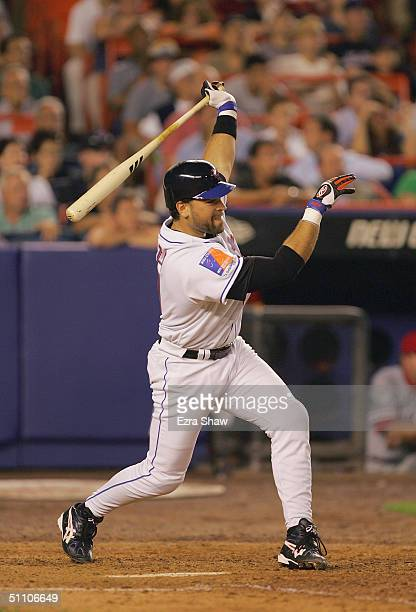 Catcher Mike Piazza of the New York Mets swings at a Philidelphia Phillies pitch during the game at Shea Stadium on July 15 2004 in Flushing New York...