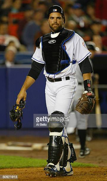 Catcher Mike Piazza of the New York Mets walks during the game against the San Francisco Giants at Shea Stadium on May 4 2004 in Flushing New York...