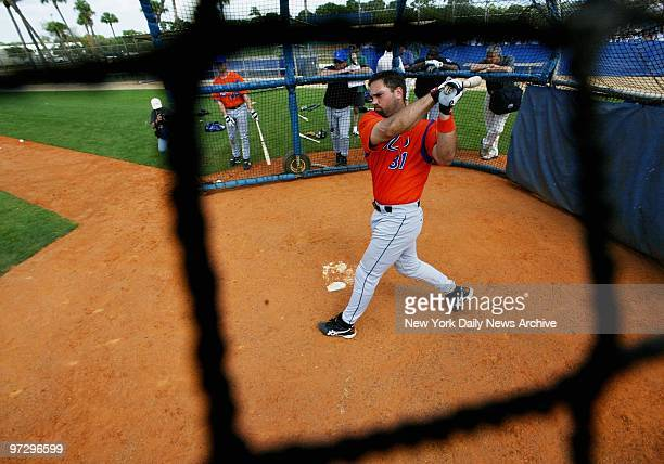 Catcher Mike Piazza takes his turn in the batting cage at the New York Mets' spring training camp in Port St Lucie Fla