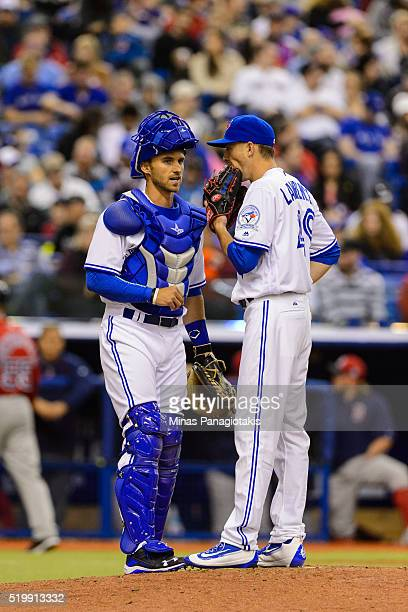 Catcher Mike Reeves of the Toronto Blue Jays speaks with pitcher Casey Lawrence during the MLB spring training game at Olympic Stadium on April 2...