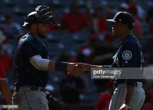 Catcher Mike Zunino and closing pitcher Edwin Diaz of the Seattle Mariners shake hands after their MLB game against the Los Angeles Angels of Anaheim...