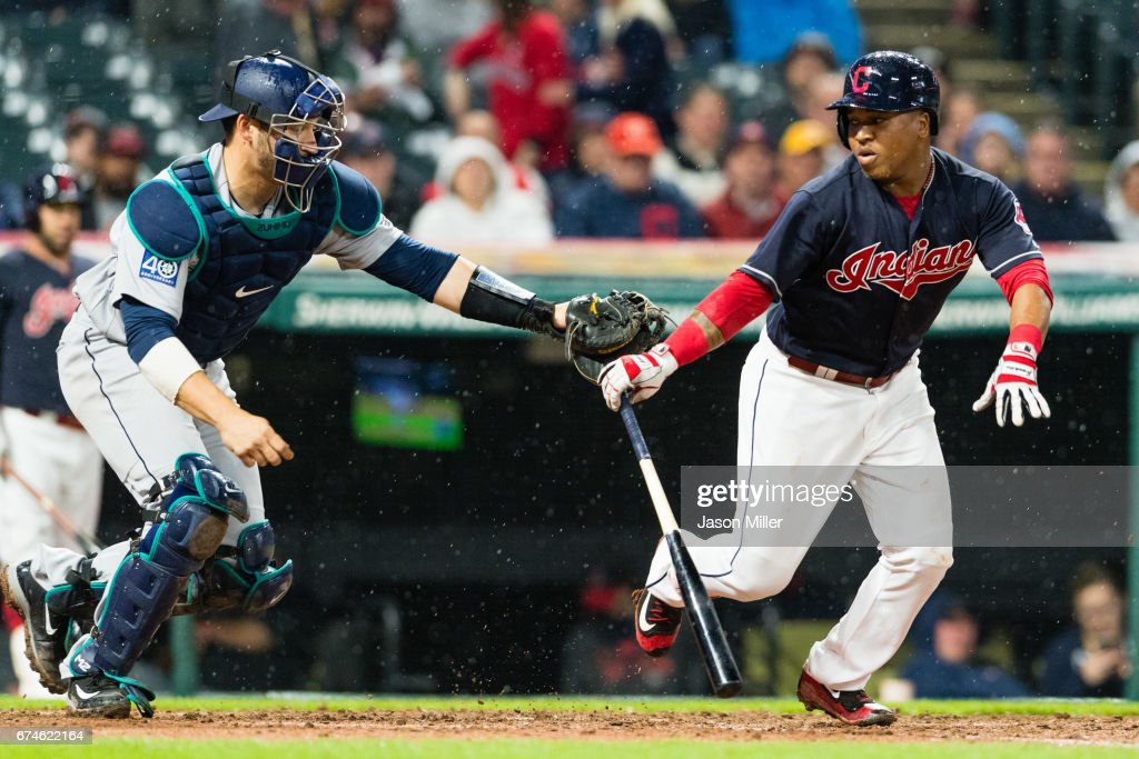 Catcher Mike Zunino #3 of the Seattle Mariners chases down Jose Ramirez #11 of the Cleveland Indians on a dropped third strike during the ninth inning at Progressive Field on April 28, 2017 in Cleveland, Ohio. The Mariners defeated the Indians 3-1.