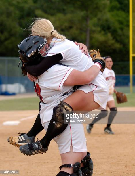 Catcher Mo Baney left and pitcher Michelle Schlichting of the RutgersCamden Scarlet Raptors celebrate after the final out against the St Thomas...