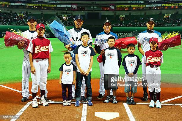 Catcher Motohiro Shima of Samurai Japan and Head Coach Hiroki Kokubo of Samurai Japan and Head Coach Hideki Kuriyama of Hokkaido NipponHam Fighters...