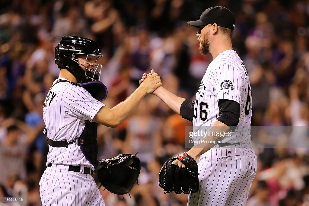 Catcher Nick Hundley #4 and closer John Axford #66 of the Colorado Rockies celebrate their 2-1 victroy over the San Francisco Giants at Coors Field on September 4, 2015 in Denver, Colorado.