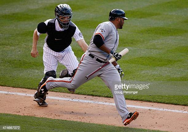 Catcher Nick Hundley of the Colorado Rockies tags out Jean Machi of the San Francisco Giants after Hundley dropped the ball when Machi struck out...