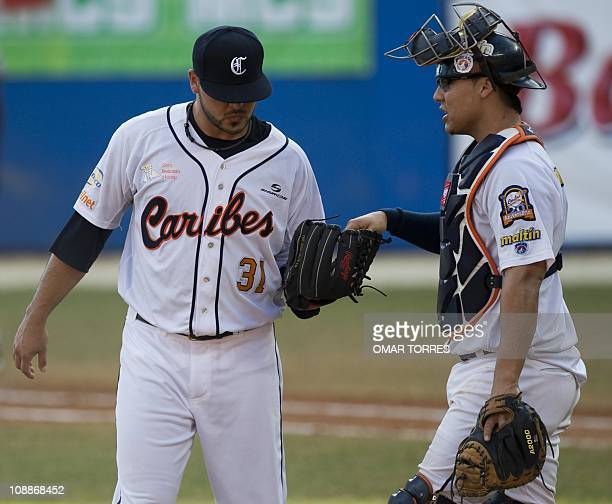 Catcher of Venezuela Jose Gil talks to the opener pitcher Manuel Ayala during the third inning of the Caribbean Baseball Series game against...